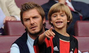 Romeo Beckham with his father David