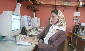 A woman at an internet cafe in Tehran.