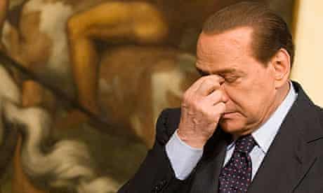 Silvio Berlusconi reflects during a press conference in Rome.