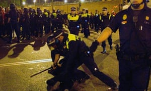 Police detain a protester in Madrid, Spain
