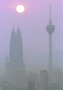 Kylie Tanti Marion was part of a group training to base jump from the KL Tower (r) in Kuala Lumpur.