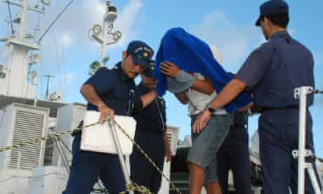 Captain of Chinese fishing boat taken ashore