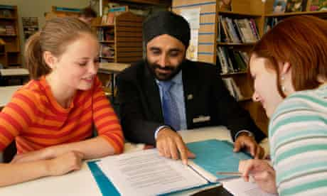 A Sikh teacher with sixth-form students