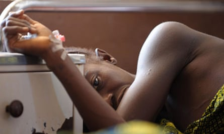 A woman waits for treatment in the mater
