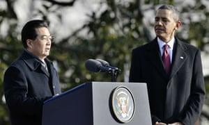 US President Barack Obama (R) looks on a