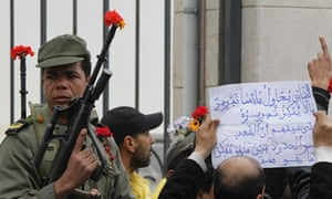 Tunisians protest outside the former ruling party's headquarters