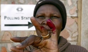 A Zimbabwean woman with dyed finger after voting
