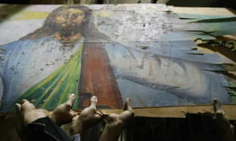 Egyptian Christians hold a blood-stained