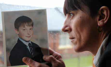 Adam Rickwood's mother holds a photo of him