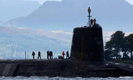 A Vanguard class nuclear submarine, carrying Trident missiles, leaving Faslane