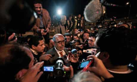 Mohamed ElBaradei gives an impromptu press conference at Cairo airport