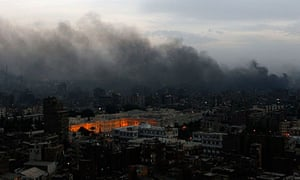 Fires rage in central Cairo following clashes between protesters and police