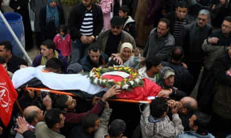 Mourners carry the body of Jawaher Abu Rahm