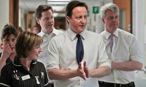 NHS cuts frontline: David Cameron, Nick Clegg  and Andrew Lansley at Frimley Park hospital, Surrey