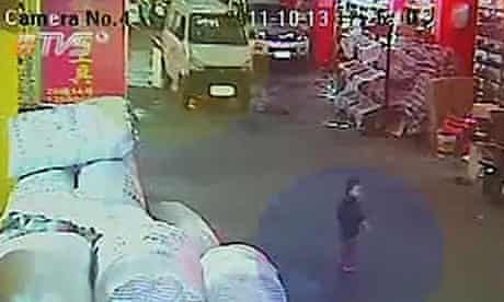 A two-year-old girl called Wang Yue, just before she is hit by a van in Foshan, south China