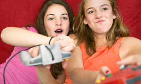 Two teenage sisters battle it out on a games console.