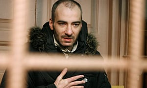 Vasily Aleksanyan speaks from behind bars in a Moscow court at his trial, in February 2008,
