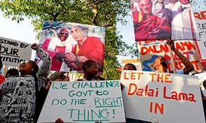 Supporters of the Dalai Lama protest outside parliament in Cape Town.