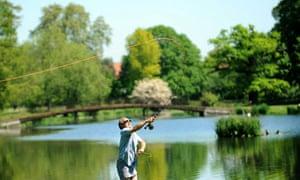 A fisherman at Syon Park fishery, near Brentford