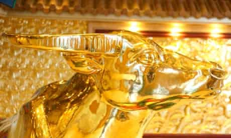 A solid-gold statue of an ox in the tower at Huaxi