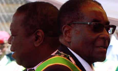 Robert Mugabe, right, who blames the west for toppling Arab autocrats, and Morgan Tsvangirai.