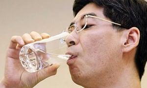 Yasuhiro Sonoda drinks a glass of decontaminated water