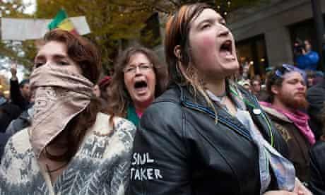 Women chat slogans near the former Occupy Portland encampment