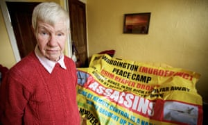 Helen John, 73, with a banner protesting against drones, November 2011