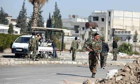 Soldiers patrol in the city of Homs, which has seen clashes for several weeks.