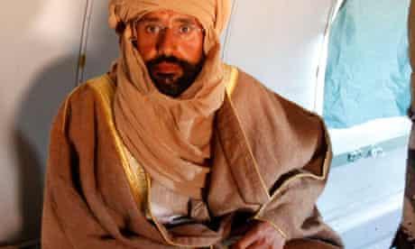 Saif al-Islam Gaddafi is seen sitting in a plane in Zintan