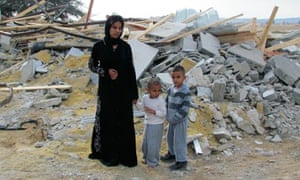 A Bedouin woman and children