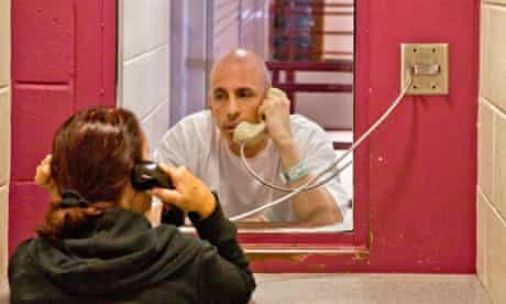 A prisoner talks with his wife in California