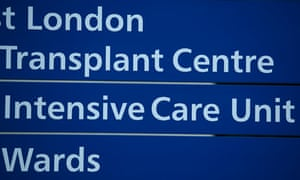 Signs for the transplant centre, intensive care unit and wards at the Hammersmith Hospital