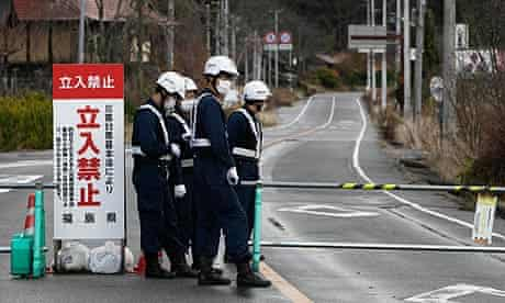 Police man a road block at the edge of the 20km exclusion zone around the Fukushima Daiichi plant.