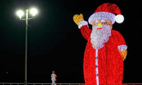 A giant, illuminated Santa Claus