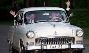 Vladimir Putin allows George W Bush to take the wheel of one of his vintage Volgas