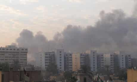 Smoke rises from the site of a bomb attack in central Baghdad
