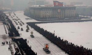 A: Limousine with a portrait of late North Korean leader Kim Jong-il leading his funeral procession