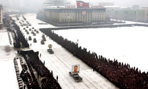 B: Limousine with a portrait of late North Korean leader Kim Jong-il leading his funeral procession