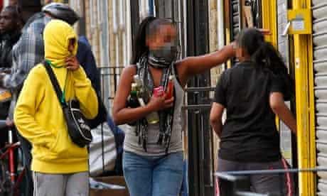 Rioters looting a shop in Hackney, London