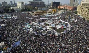 Demonstrators perform the Friday noon prayer during protests in Cairo's Tahrir Square.