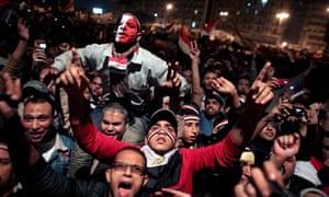 Egyptians celebrate the news of the resignation of Hosni Mubarak