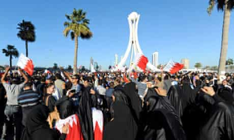 Protesters in Bahrain celebrate after reaching Lulu Square in the capital city of Manama
