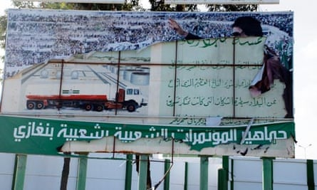 A torn poster of Colonel Gaddafi in Benghazi, Libya.