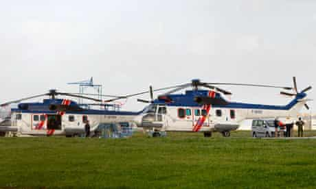 Two civilian helicopters are seen at Malta International Airport