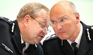 Deputy Commissioner Tim Godwin, left, with Commissioner Sir Paul Stephenson