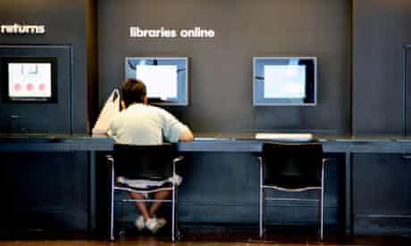 Internet user in public library, London, England