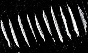 image of lines of cocaine powder on black surface