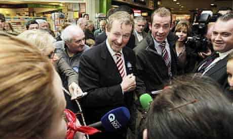 Enda Kenny meets people on a final canvas at Donaghmede shopping centre in Dublin.