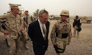 Donald Rumsfeld during a tour of the notorious Abu Ghraib prison in 2004